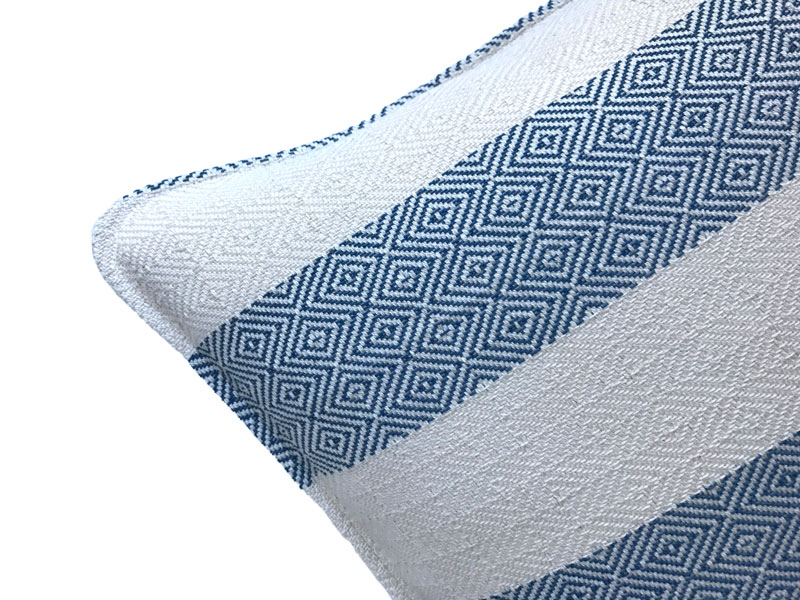 white and blue tribal pattern pillow cover close up
